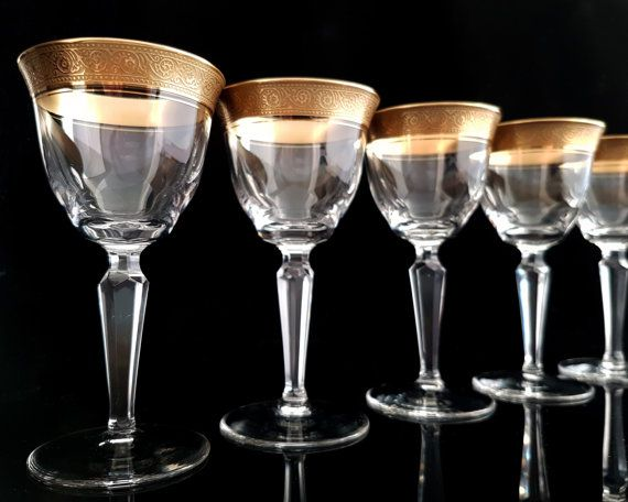 """Rare Mid Century crystal wine glasses with a gold rim manufactured by THERESIENTHAL in W. Germany.  Decor: Concord with Mintonborte. This is a classical series from 1950s. Typically for this period, it combines elegance with function. Each glass is decorated with rich textured gold rim, the """"Mintonborte"""".  In very good vintage condition - no damages. Please see the pictures for more details.  Each glass is 125 mm (4.92) high. Diameter at the top 65 mm (2.56).  Total weight 550 g (1.21 lbs)…"""