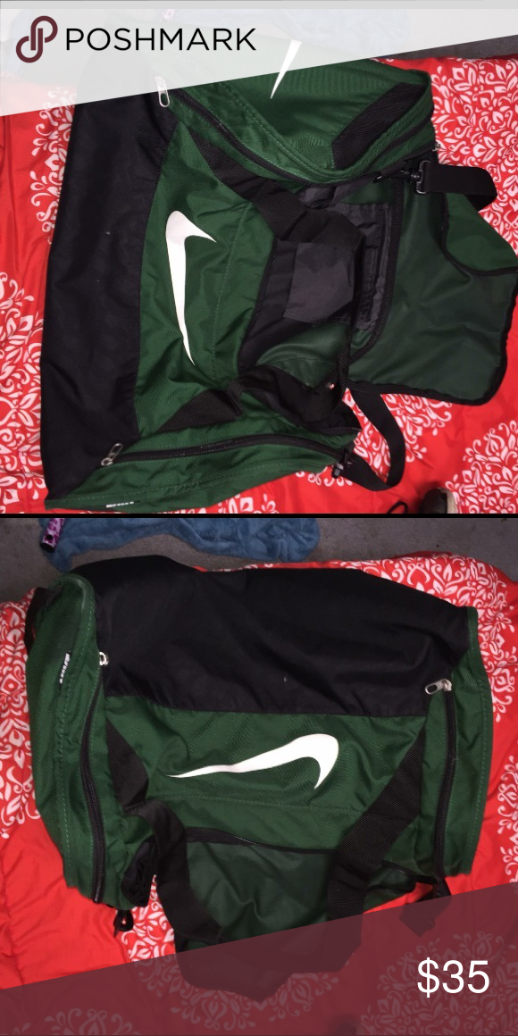 Nike duffle bag Used for a season   didn t really use after. It is a large  duffle bag. Dark green color Nike Bags 6b7c641a5e