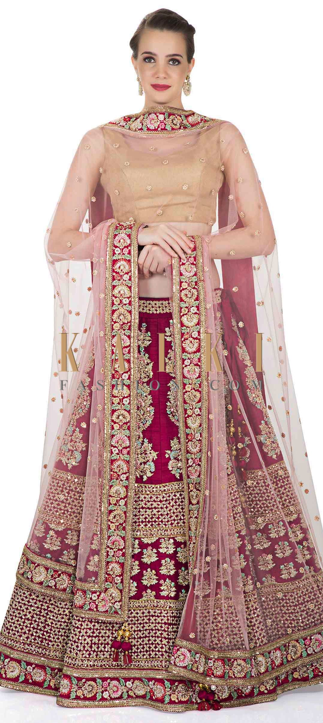 e98ab66f9d Rani Pink Raw Silk Lehenga, Blouse and Pink Net Dupatta with Resham,  Sequins and Zari only on Kalki
