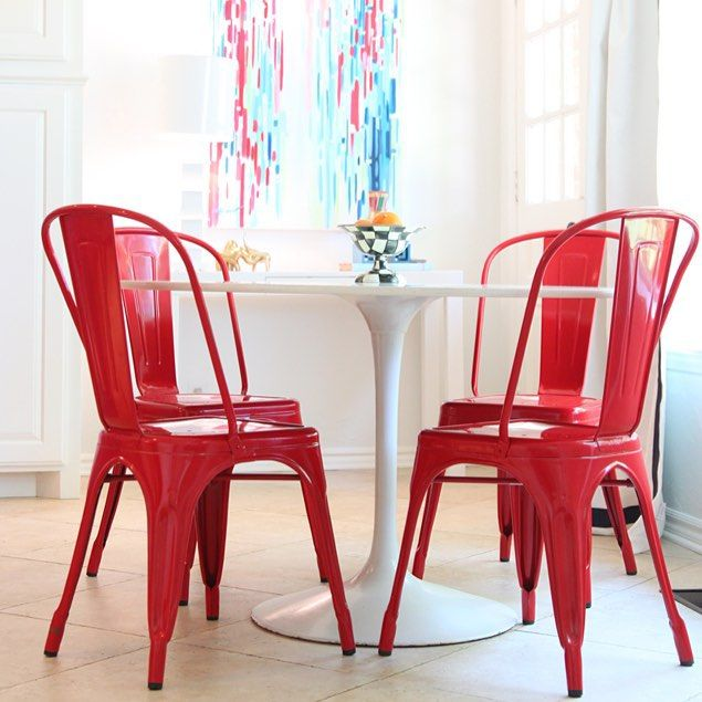 red tolix marais chairs with saarinen style tulip table http
