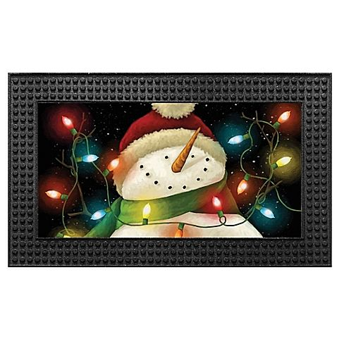 This special holiday Light-Up LED Snowman Door Mat greets your