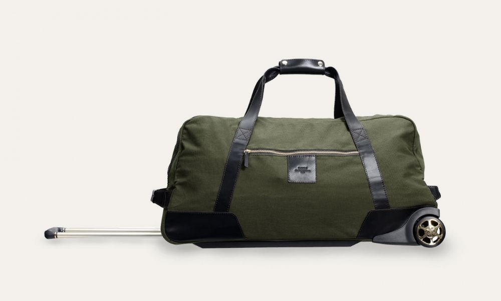 9b78dd9597db Baron Large Duffel Bag on Wheels - Green This double-handle bag silhouette  is the perfect leisure bag with plenty of room for just about anything It
