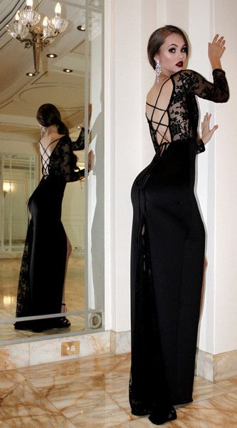 CHANEL O'DELL the evening gown with low back, lace up, and lace sleeves. All black everything.