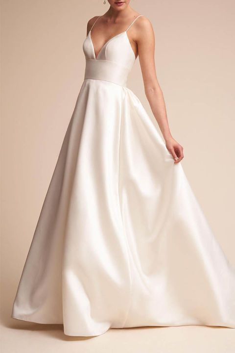 Ballgowns can get fussy quick, but this wedding dress is the picture of elegance. Sweeping satin perfectly offsets the simple spaghetti-strap top, and there are even pockets hidden at the sides! It's a dress that'll still feel current no matter how much time goes by. #quickweddingplanning