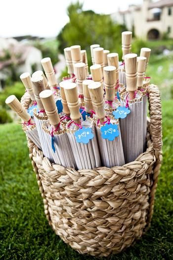 Fans and parasols serve as practical favors your guests can use long after w-day! Perfect for a summer wedding in the South!