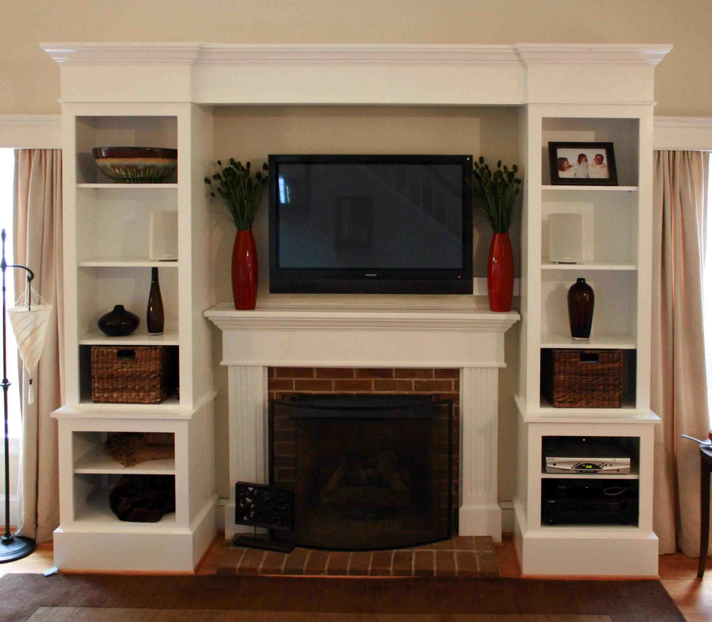 Foxy white custom built in cabinets fireplace entertainment center with open shelves storage as modern living