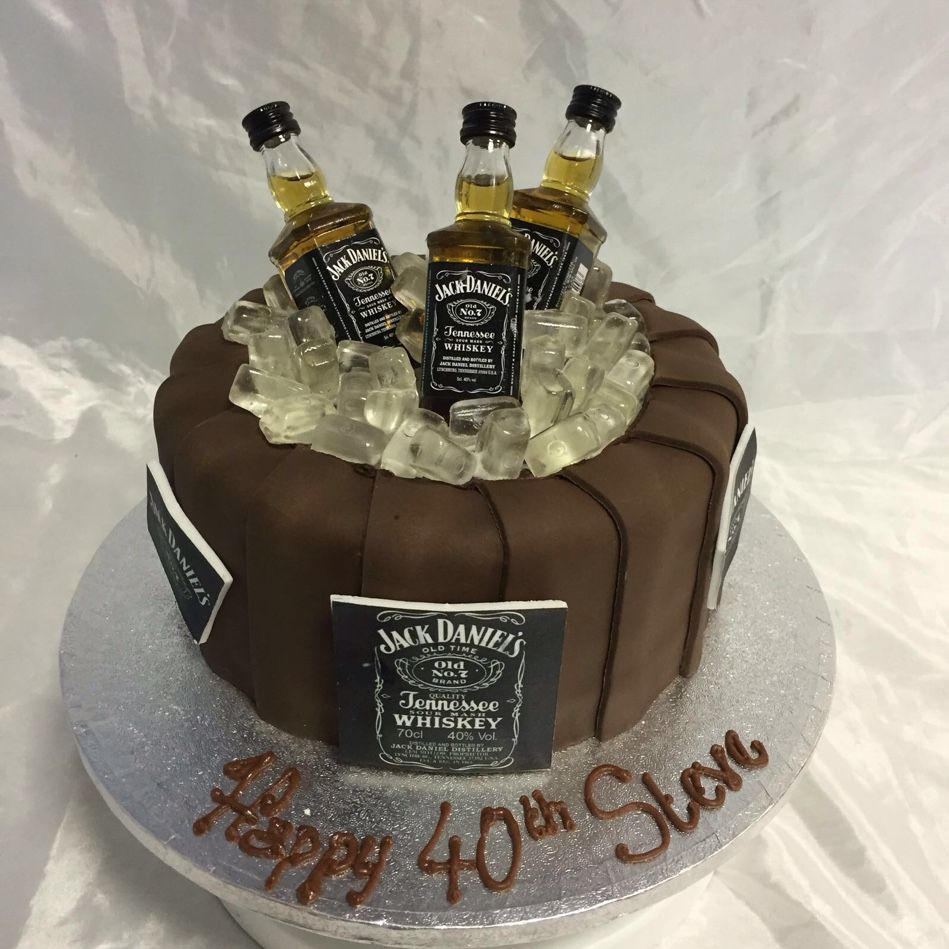Jack Daniels cake with miniature bottles on top #jackdaniels ...