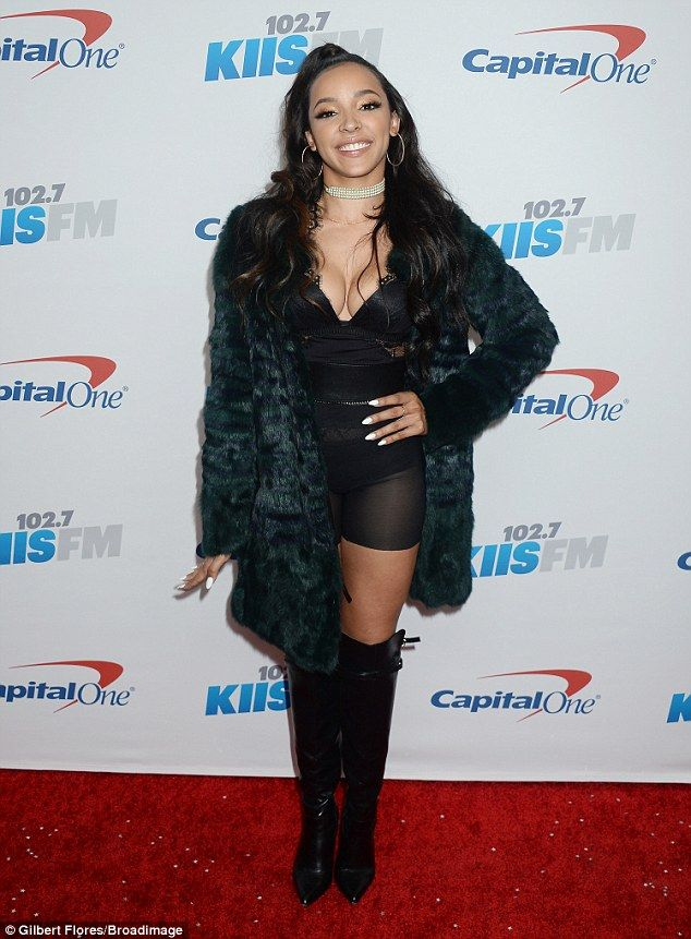 Busting out: Singer Tinashe opted to put her substantial cleavage on display in a plunging...
