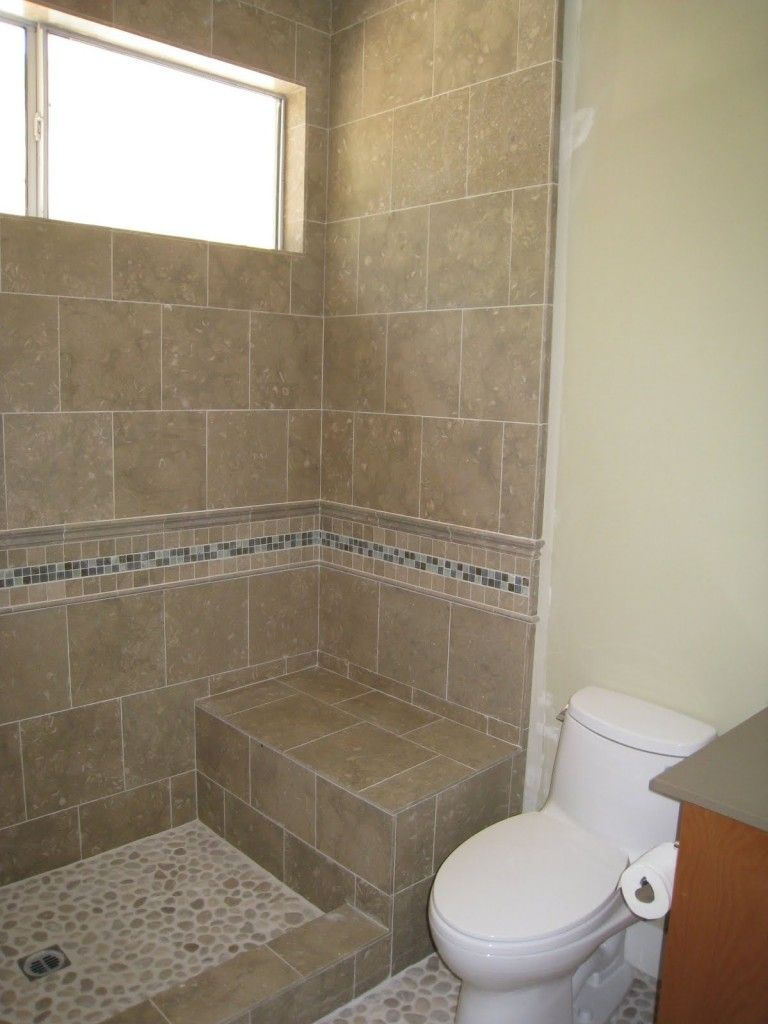 Shower stall without door with border tile and chair for simple bathroom showers shower stalls Bathroom remodeling ideas shower stalls