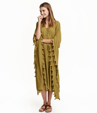 b49600d0fa Calf-length kaftan dress in woven, crinkled viscose fabric with decorative  trim. V-neck, drawstring at waist, and slits at sides. Unlined.