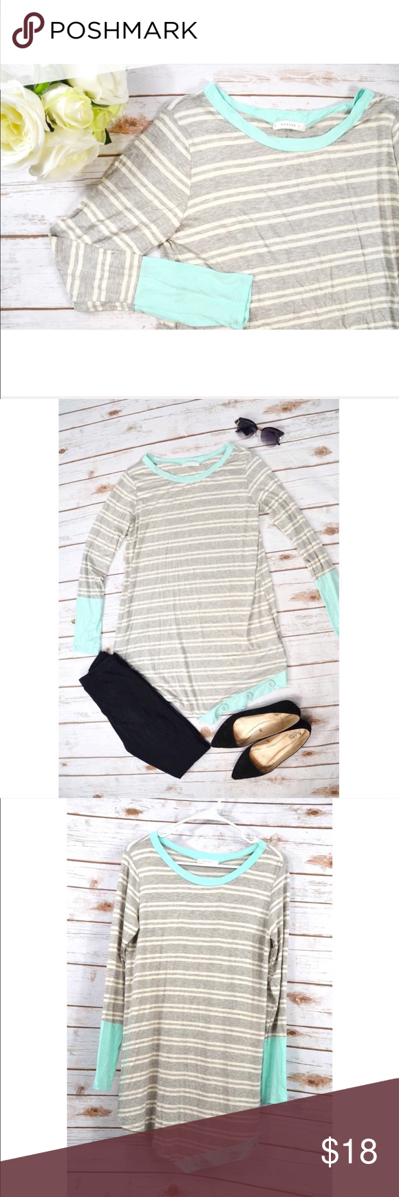 """🌸 Stripes & Buttons Tunic 🌸 This tunic is so cute & perfect for Spring! Both flowy & comfy! Has button accents along the bottom front. Long sleeves, grey & white stripes with pastel teal accents & neckline. Loose fit. Size LARGE.   🌸Bust: 36"""" 🌸Waist: 44"""" ❌ NO TRADES 🌸 Bundle to SAVE 💸 Tops Tunics"""