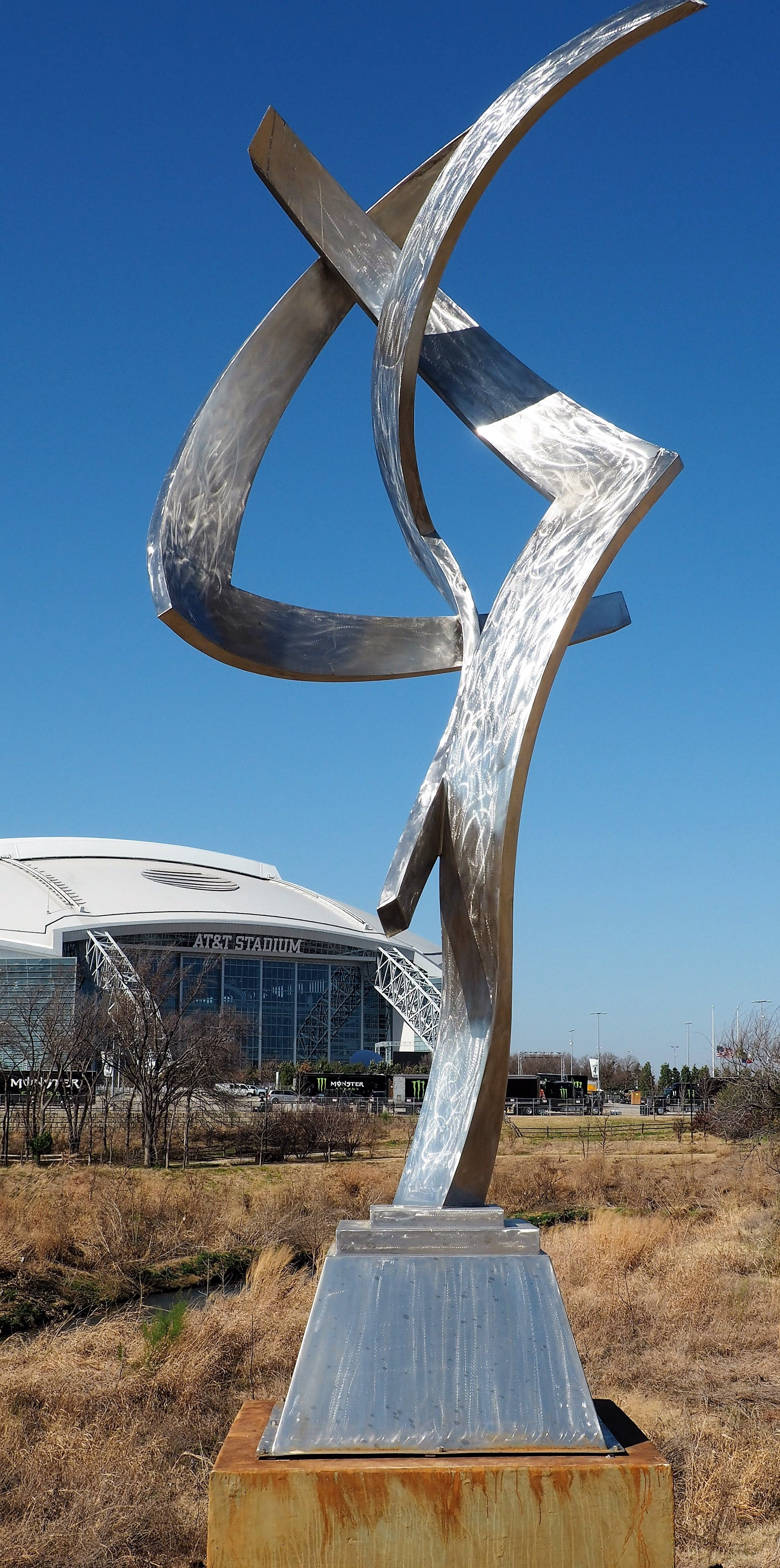 """This is """"Celestial Trio"""" by artist Bruce Niemi. It's located on the Sculpture Trail along Johnson Creek east of AT&T Stadium. Park on Randol Mill to visit the park, but take note: Avoid game or event days for the Cowboys or Rangers. There will be no such parking on those days."""