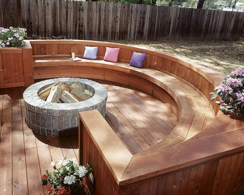 Conversation deck brick fire pit built into a sunken for Circular garden decking