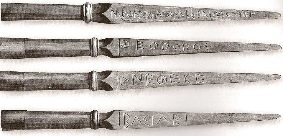 """Butt-caps for Greek spears. Discovered at the shrine of Olympia and bearing the inscription: """"From the Spartans, Theodoros dedicates this to the king [Zeus]."""" A Greek spear's butt-cap is often called a sauroter, """"lizard-killer."""""""
