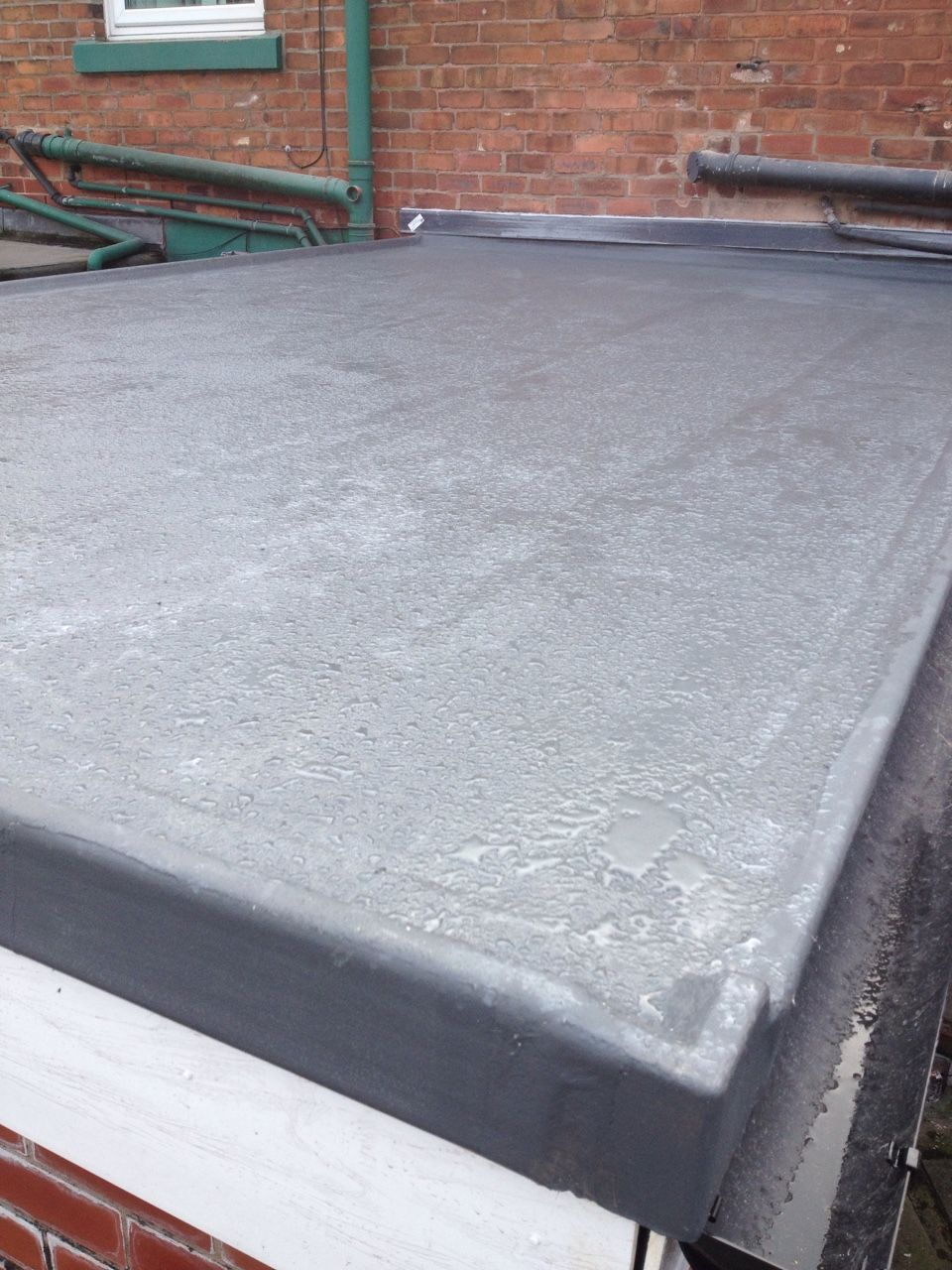 We Transformed This House Extension Flat Roof In Manchester With A New GRP  Roofing System,