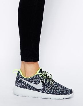 Edgy leopard print Nike Rosherun sneakers with a hint of neon lime peeking  from the edges 147c5584f