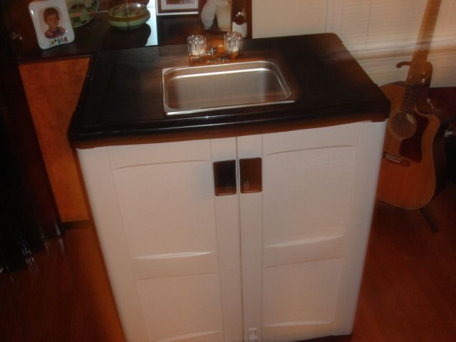 Outdoor Sink Using A Rubbermaid Outdoor Cabinet To Put It