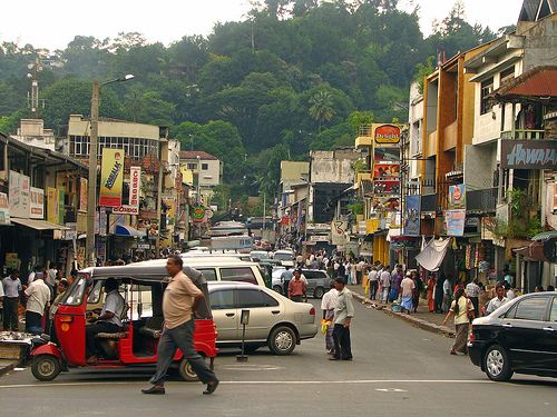 I couldn't remember this place, and finally it came to me; Kandy, Sri Lanka. Visited it in 1999. Great place. Monkeys everywhere.