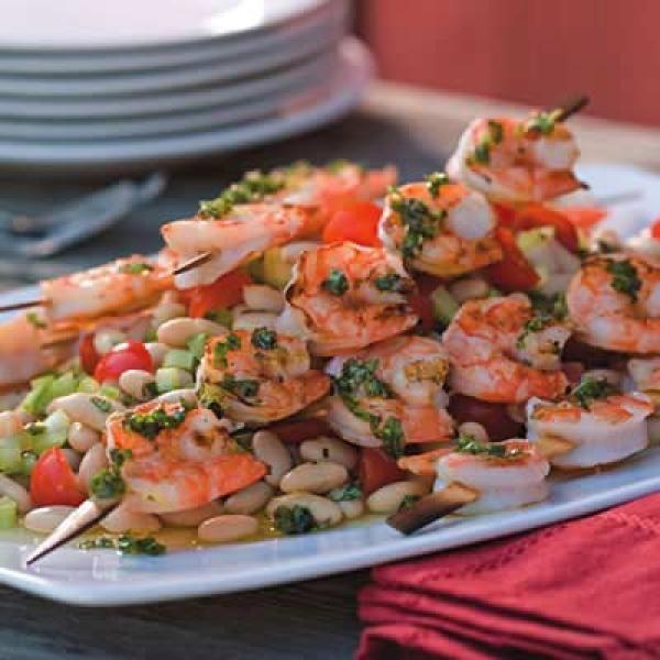 Grilled Shrimp Skewers over White Bean Salad   | KitchenDaily.com