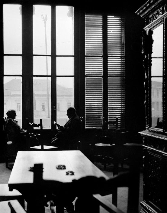 Herbert List.   ITALY. Milano. 1950. Casa Verdi (retirement home founded by Guiseppe Verdi). Seated in the window of the library are the pianist Concette ABATE and the tenor Giovanni BANBACIONI.    Magnum Photos -