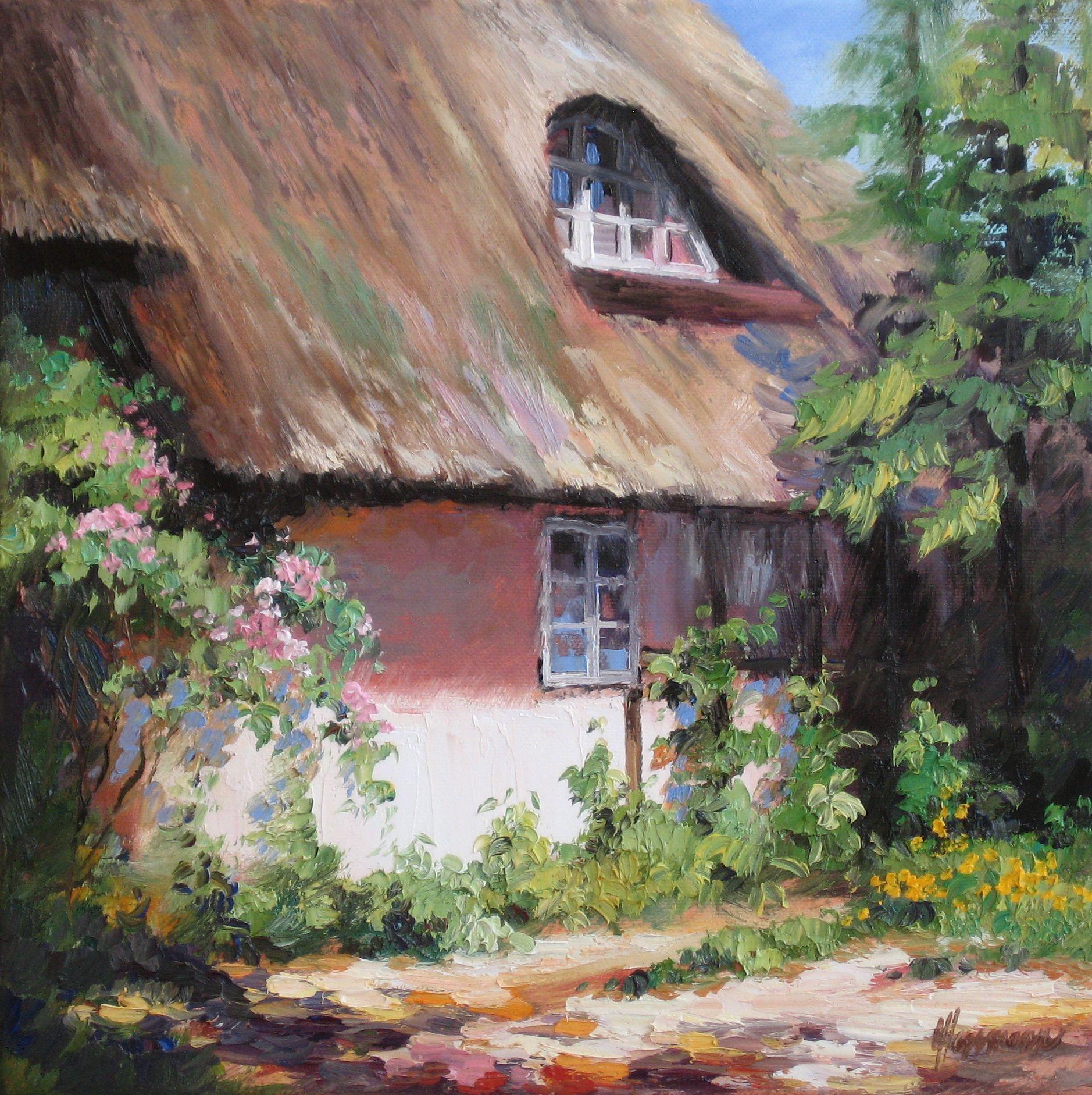 Ein gemütliches Reetdachhaus an der Ostsee, umgeben von