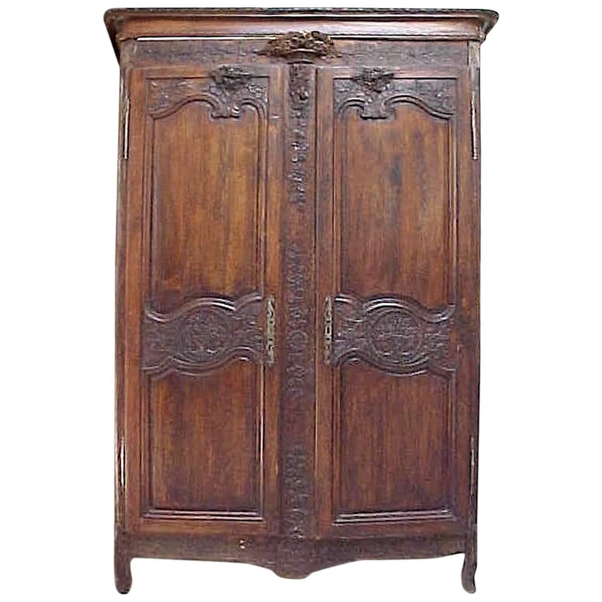 18th Century French Country Highly Carved Walnut Wedding Armoire