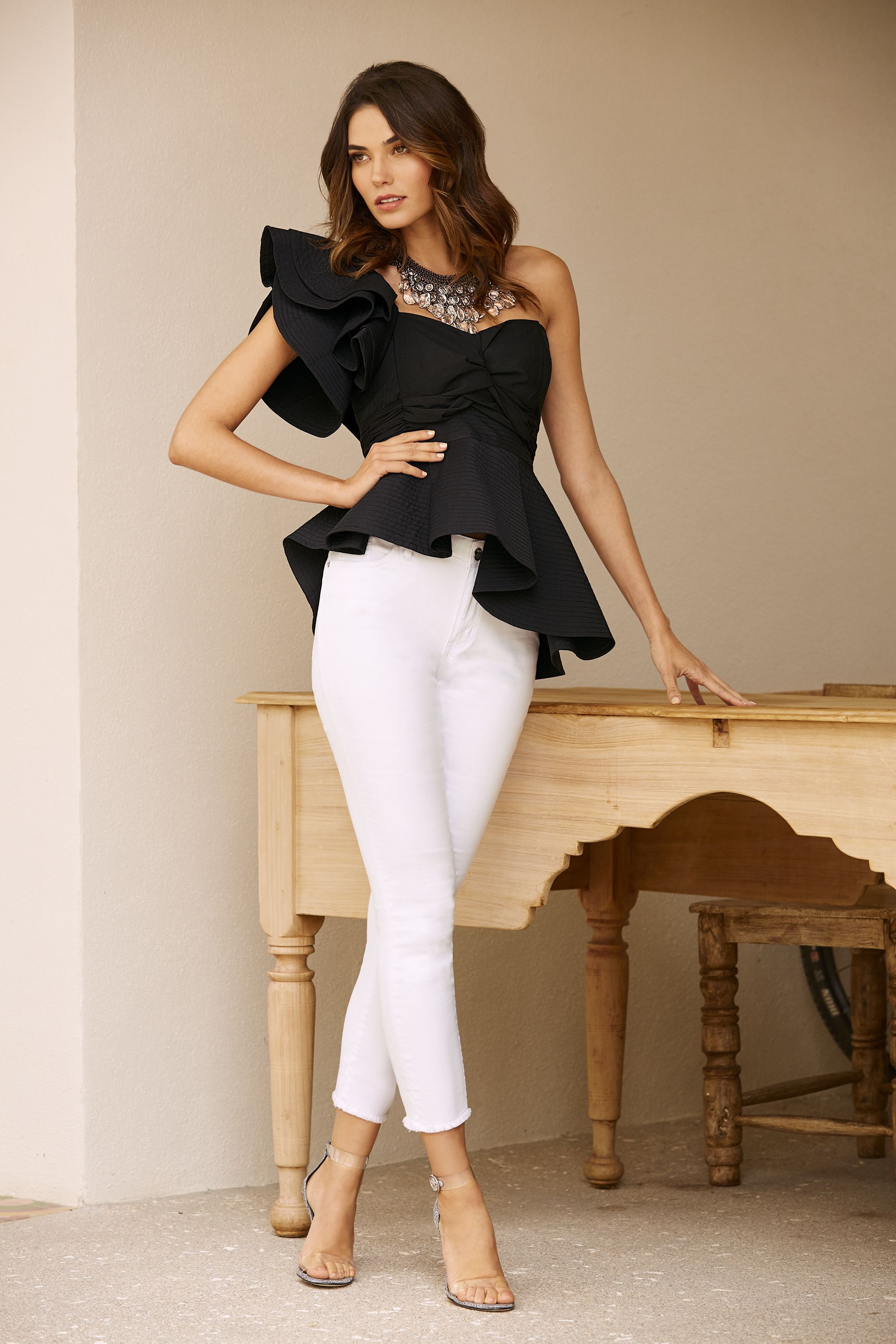 841639df6c2 Women s Asymmetrical Peplum Top paired with our Frayed Hem Ankle Jean by  Boston Proper.  asymmetrical  ruffle  peplum  top