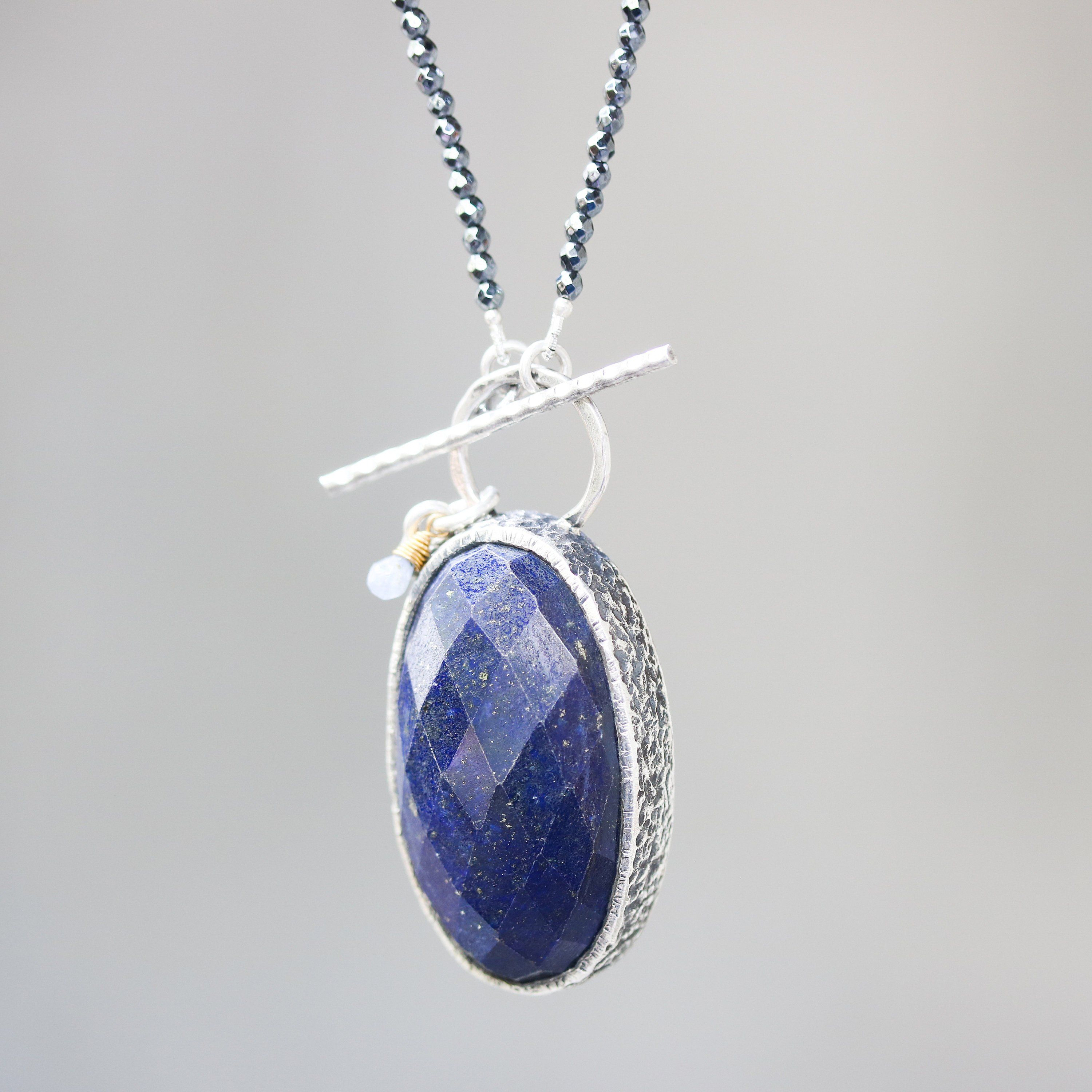 Tiny faceted hematite necklace with oval faceted lapis lazuli
