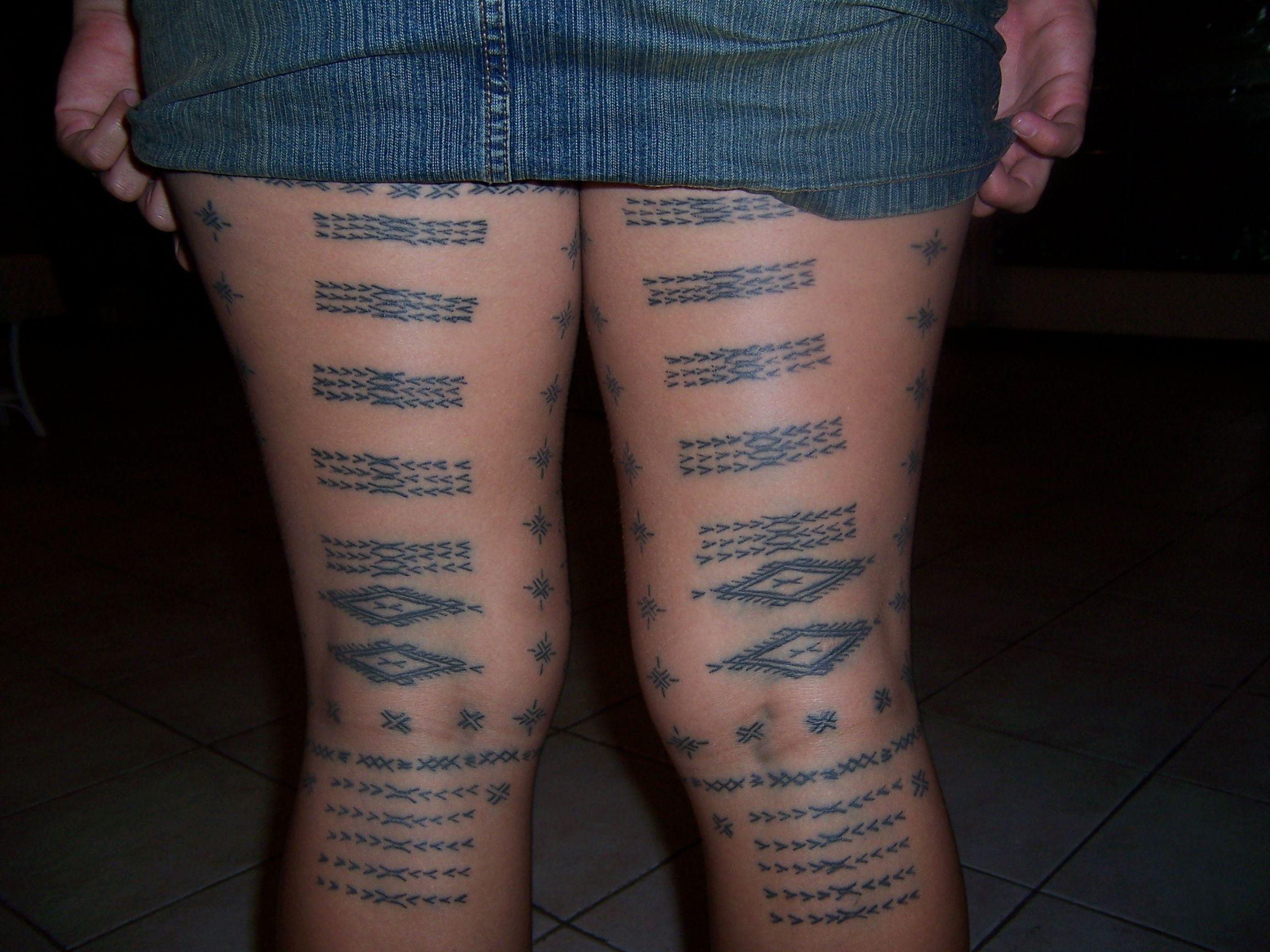 Samoan woman with a traditional malu tattoo cross cultural