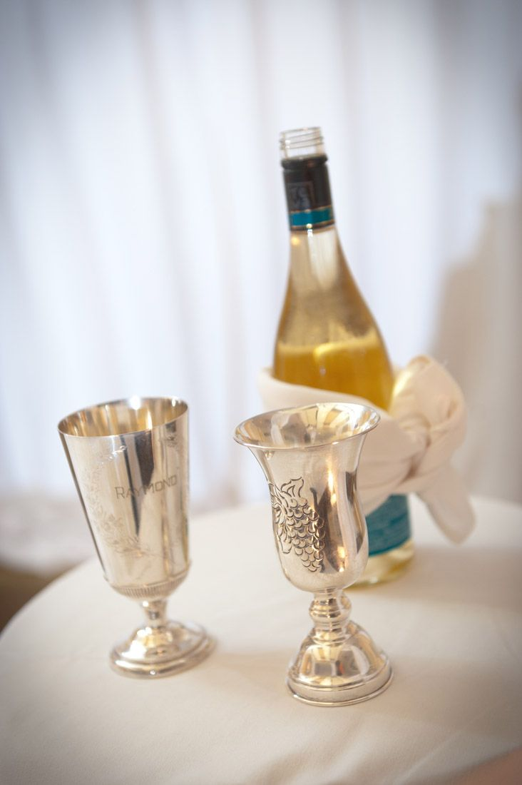 The Bride And Groom Sip From Wedding Kiddush Cup Of Wine Which Sanctifies