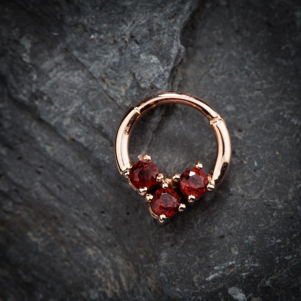 FreshTrends Luxe Faux Garnet K Gold Hinged Segment Clicker Ring
