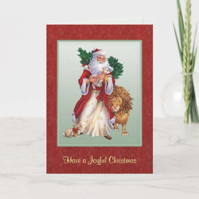 St.Nicolas carrying a christmas tree. With him is a lion and rabbit. He holds a lamb in his hand. Old-fashioned Father Christmas, European in style - with some repair work done. Beautiful card depicting St.Nicolas giving the gifts of love and friendship to all. Size: ,5