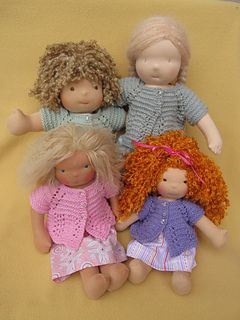 Ravelry pattern for doll cardigans.  Free.