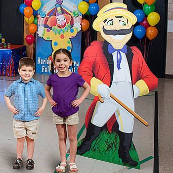 The Carnival Barker Standee has the look of a traditional barker with his red jacket, straw hat and handle bar mustache and has sound.