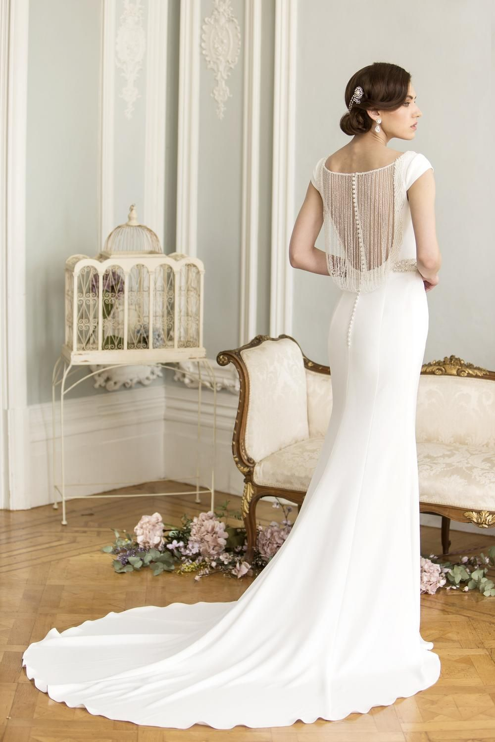Dramatic wedding dresses  Make a dramatic aisle entrance with this glamorous crepe wedding dr