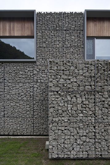 gabion walls hanil visitors center guest house bcho architects deep rough texture with crisp at