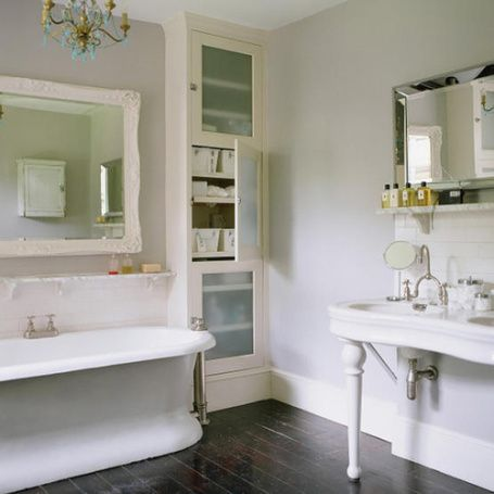 built-ins with a big mirror and hardwood floors. Pretty tub too.