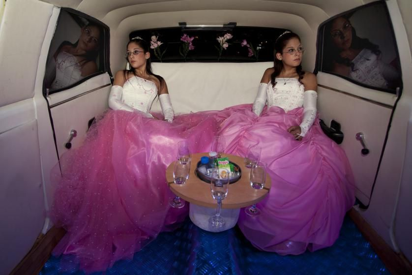 Twins Laura and Belén mark their Quinceañera — a celebration of their 15th birthday — in the back of an electric-blue 1972 Ford Fairlane limousine in Buenos Aires.
