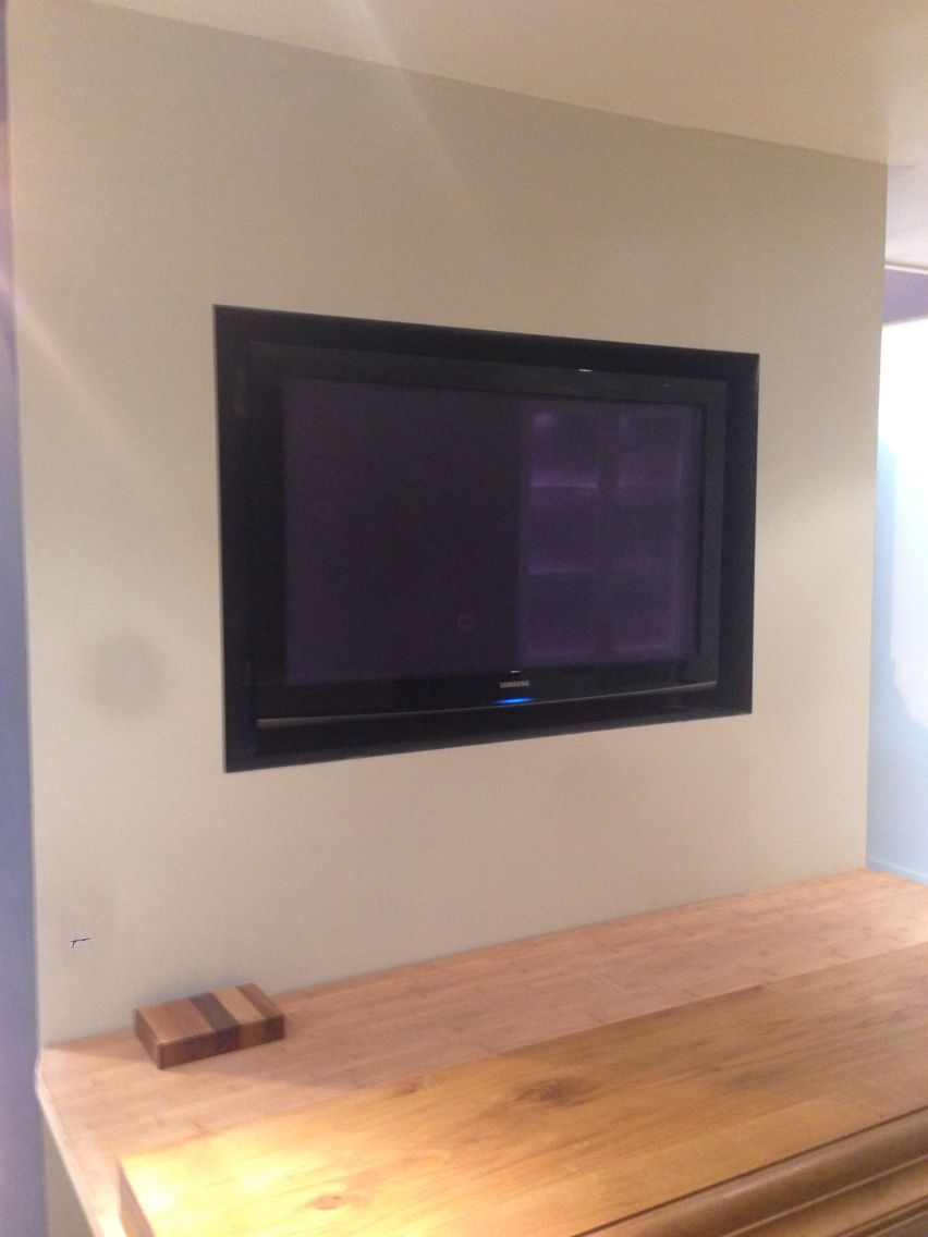 tv recessed in the chimney breast.sleek and space saving