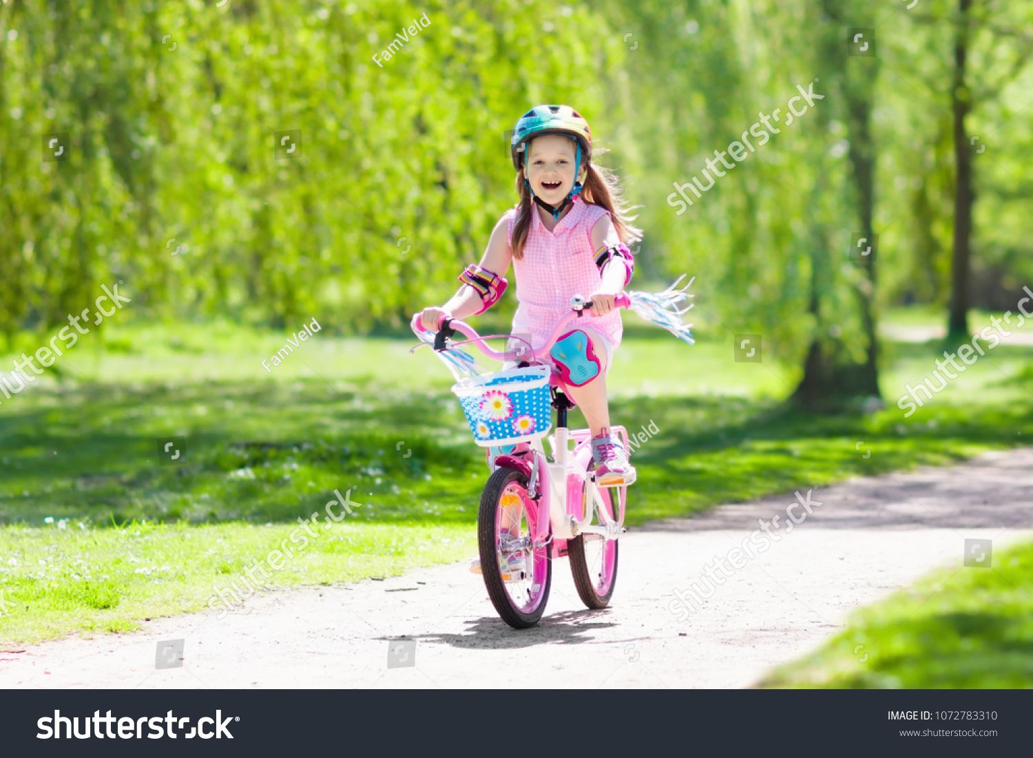 Child Riding A Bike In Summer Park Little Girl Learning To Ride A