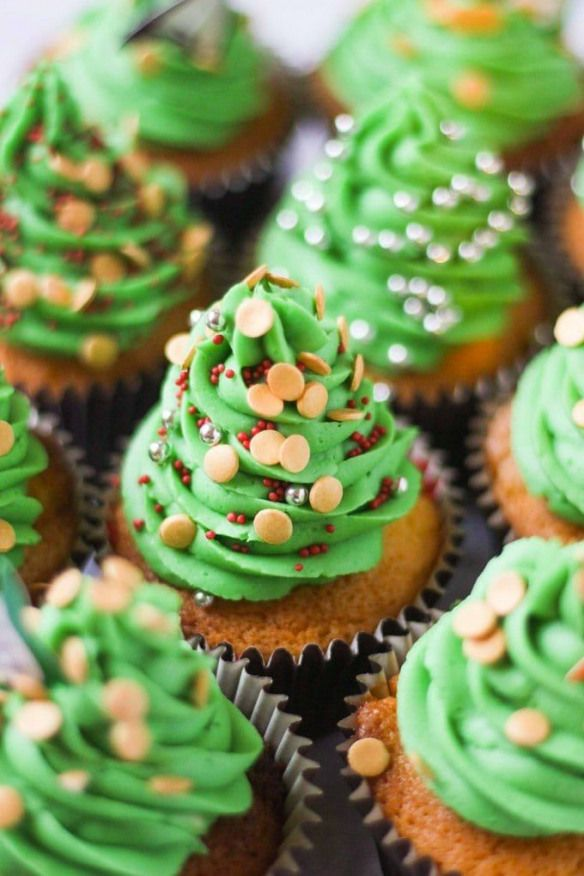 The easiest way to decorate Christmas Cupcakes - simple green icing Christmas trees Easy and fun for kids topping a fail proof vanilla cupcake recipe!