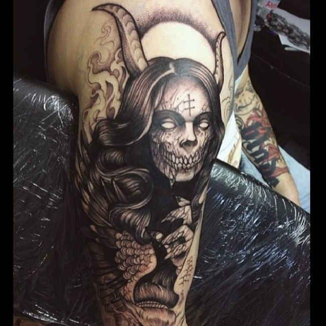 Horror Of A Woman With Devil Horns Tattoo