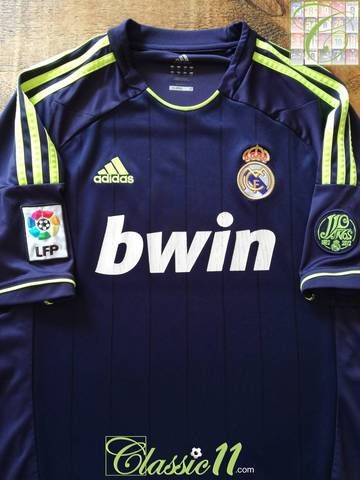 d3cacca7e Official Adidas Real Madrid away football shirt from the 2012 13 season.  Complete with La Liga patch and 110 year anniversary patches on the sleeves.