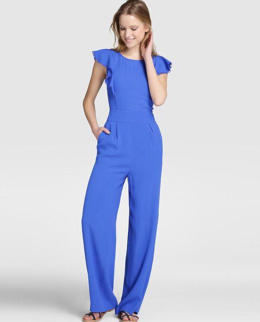 91900ae576cf Mono largo en color azul con adorno de volantes y lazo a tono en la ...