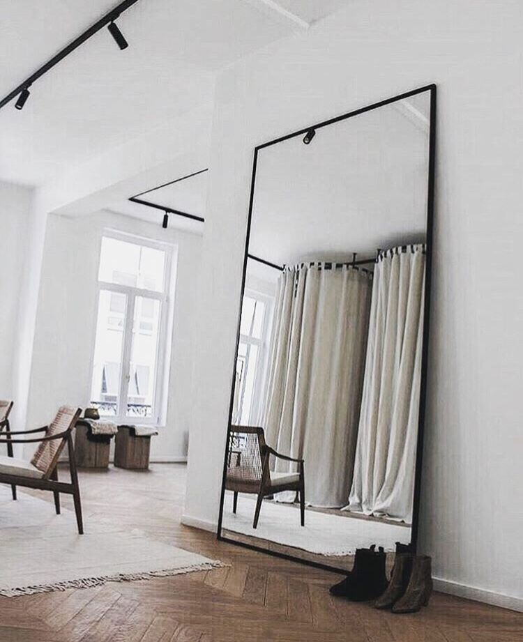 Large Mirror In Living Room.