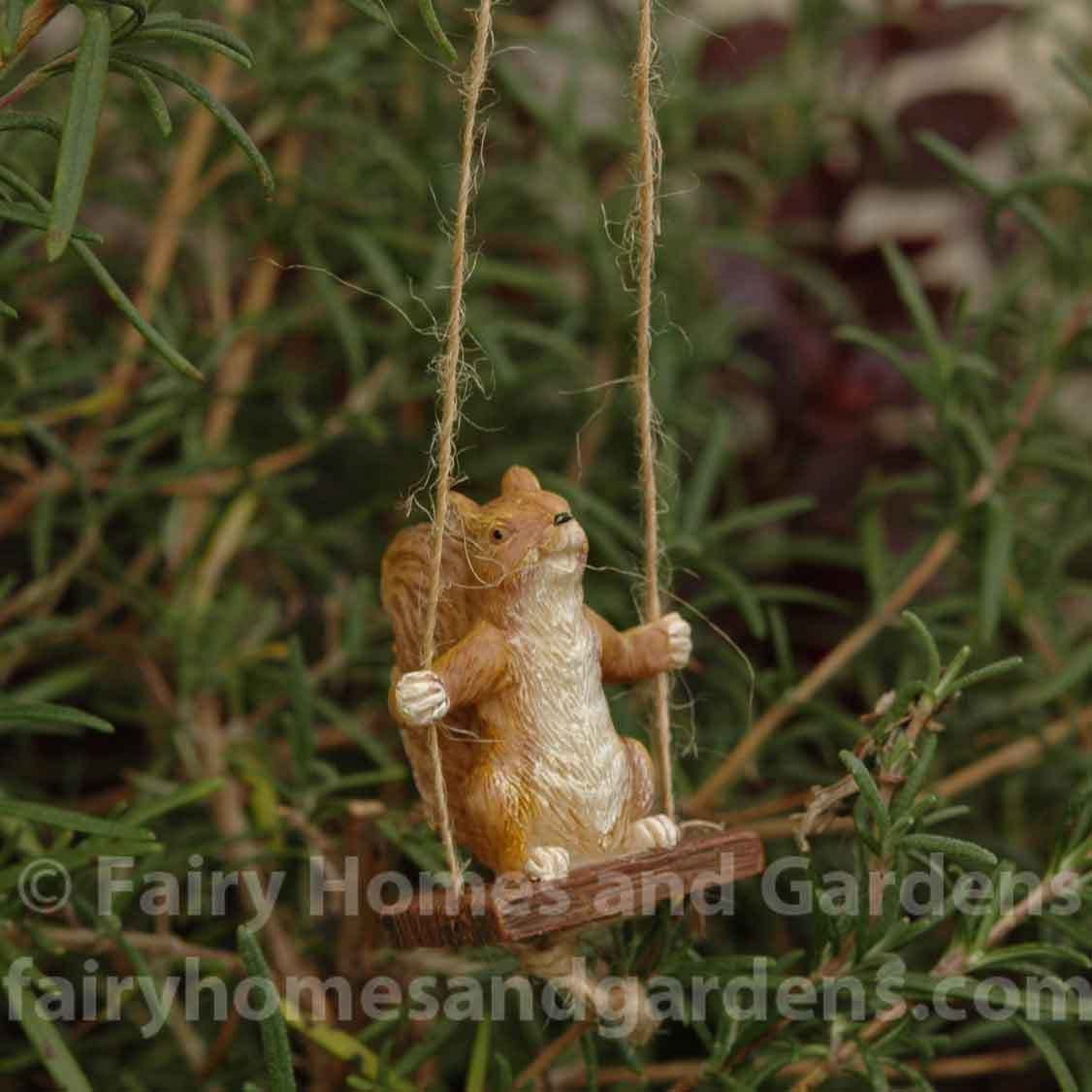 Miniature squirrel on a swing squirrel miniatures and swings