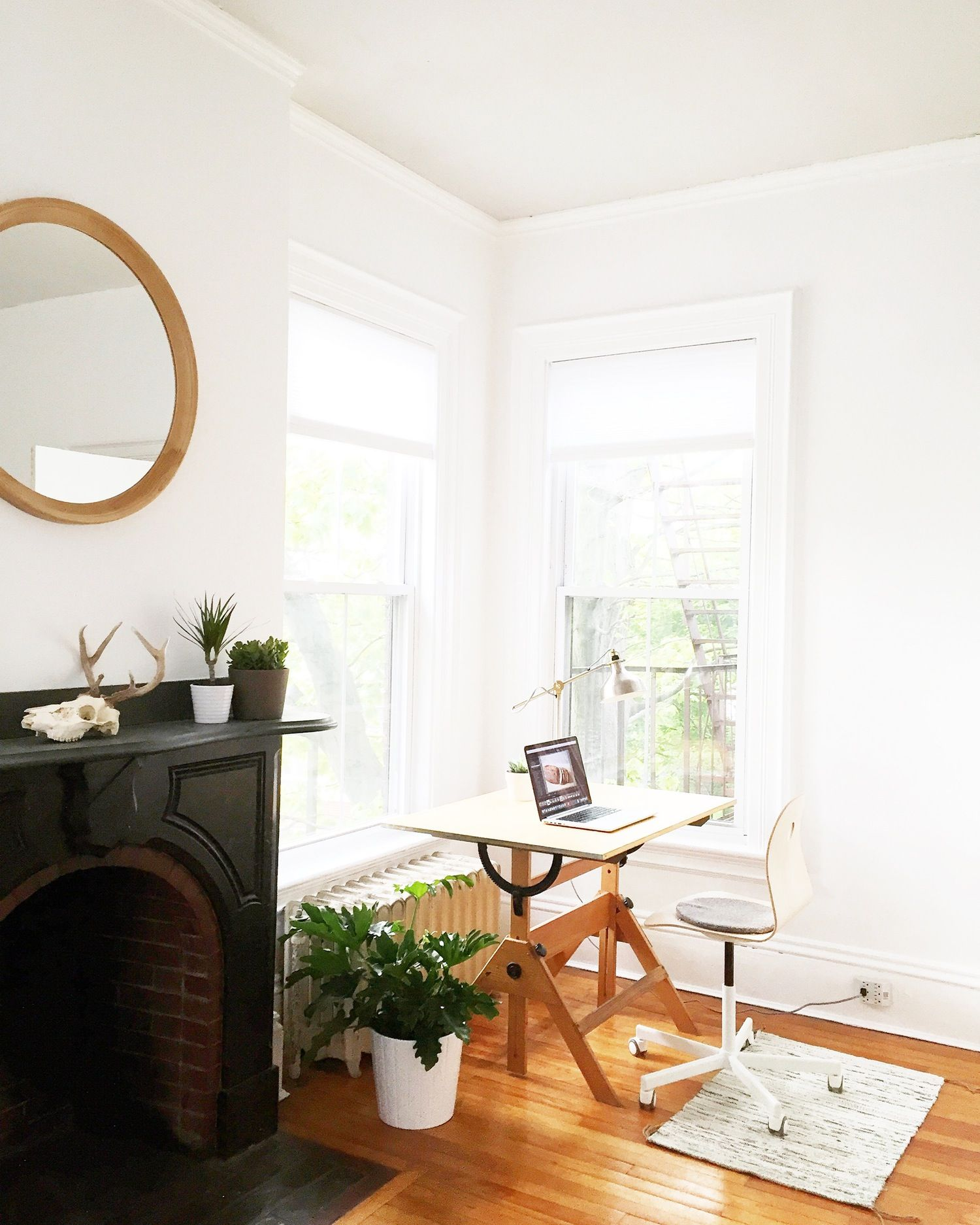 In a 950 square foot space hidden inside of a historic mid-1800s building is the new home of Danny and Lyndsay Gugger. White walls and simple Scandinavian style create a bright and comfortable live and work space ready to inspire you to create the same.
