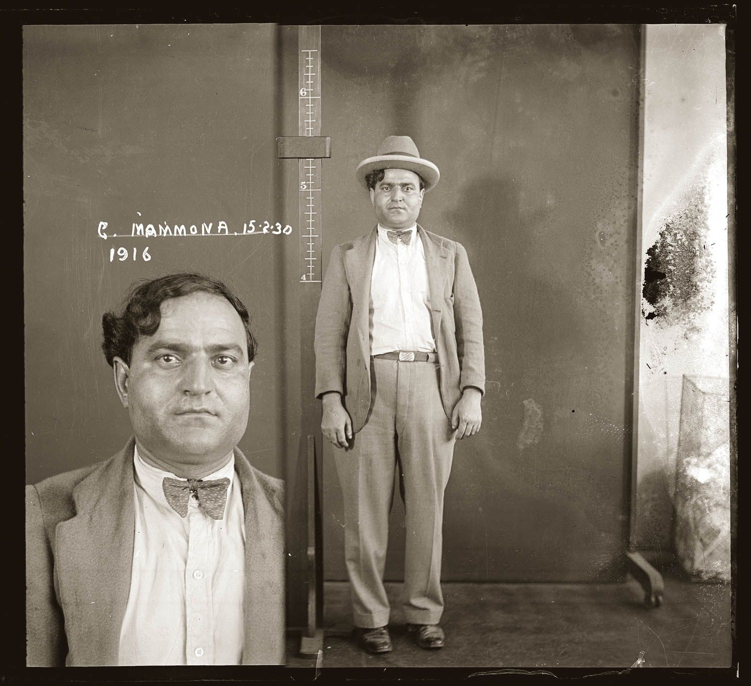 """Although labelled 'G Mammona', the mug shot shows Giuseppe Mammone, who was presumably interviewed and photographed in connection with the stabbing murder of Domenico Belle on Newtown Station, on the morning of 11 February 1930. This picture is one of a series of around 2500 """"special photographs"""" taken by New South Wales Police Department photographers between 1910 and 1930."""