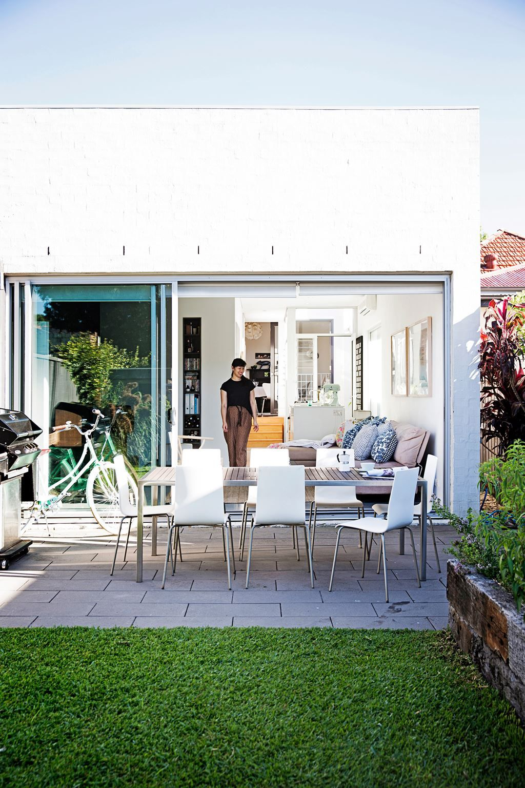 """During summer we leave the house open – there's a big glass sliding door at the back and louvres and French doors in the middle. We love having friends over for dinner and in drinks in the backyard."""