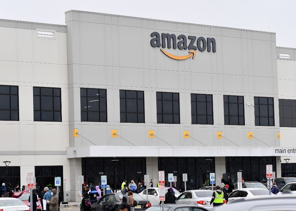 Massive fire engulfs los angeles amazon center with 40